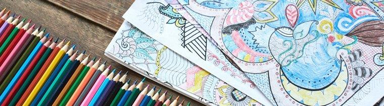 Coloring Books For Adults Catch Your Colored Pencils And Start Verschiedene Ausmalbilder Und Buntstifte Auf Einen Holztisch